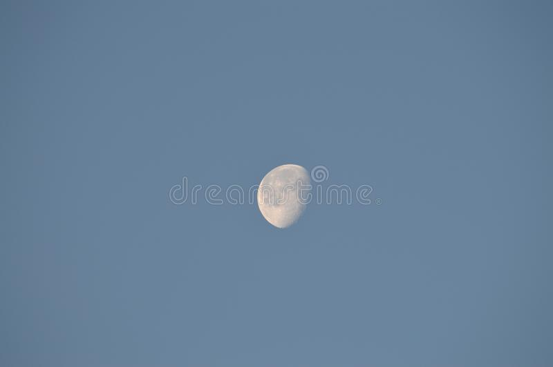 Close-up of the Moon during Sunrise. Beautiful Moonshine royalty free stock photography