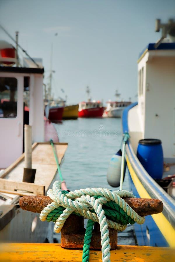Mooring ropes of fishing boats royalty free stock images