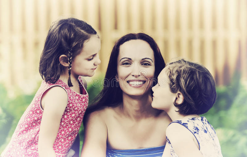 Close Up of a Mother and her Daughters - Retro stock image