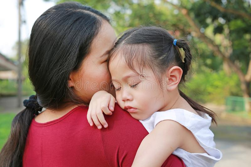 Close-up Mother holding her baby girl was crying outdoors royalty free stock photography