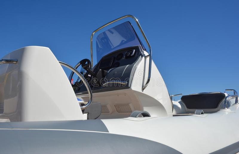 Close up on motorboat, speedboat details. A motorboat, speedboat, or powerboat is a boat which is powered by an engine royalty free stock photos