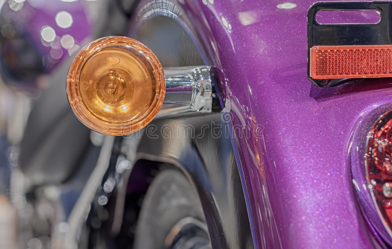 Close up of motorcycle rear light, indoor photo. royalty free stock image