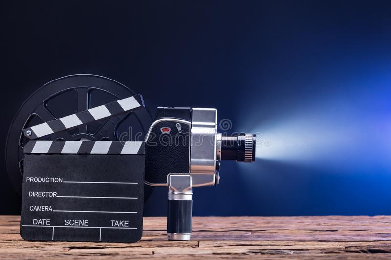Close-up Of Movie Camera With Film Reel And Clapper Board stock image
