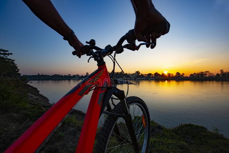 Close up of a moving bicycle from a river side royalty free stock photo