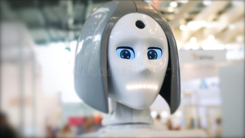 Close-up of moving and speaking female robot`s head with blue eyes. Media. Different working robots collection presented royalty free stock image