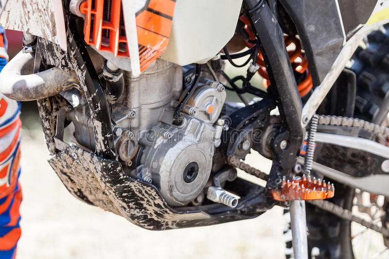 Close-up of muddy engine of dirt motorcycle stock images