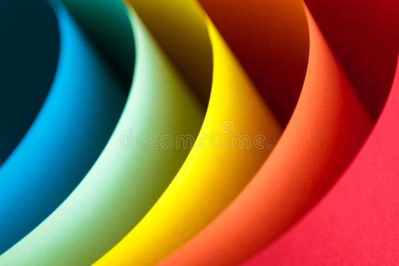 Close up of multicolored origami pattern made of curved sheets of paper royalty free stock photography