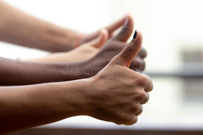 Close up of multiethnic people show thumbs up gesture royalty free stock images