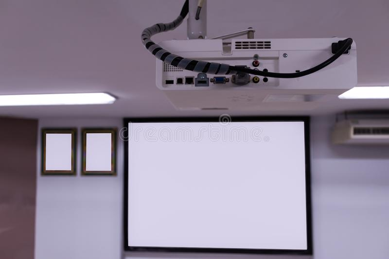 Close up Multimedia projector installed on the ceiling stock image