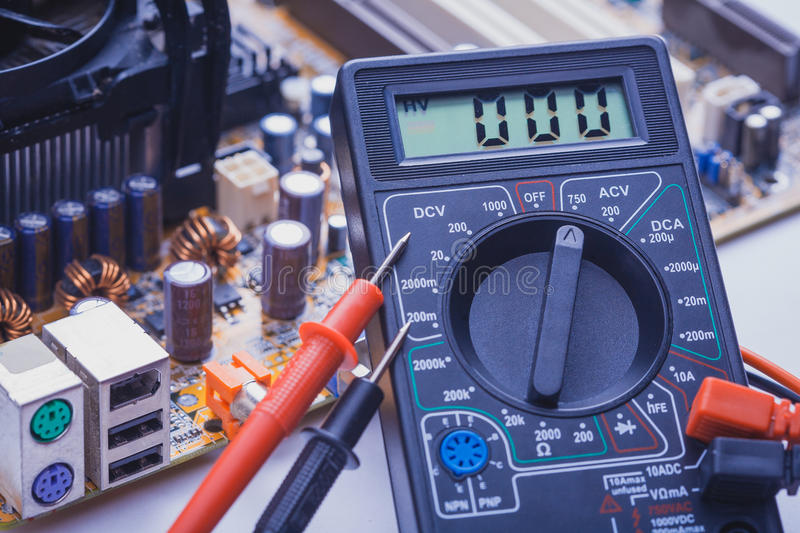 Close-up of multimeter on PCB plate. Close-up multimeter on PCB plate royalty free stock image