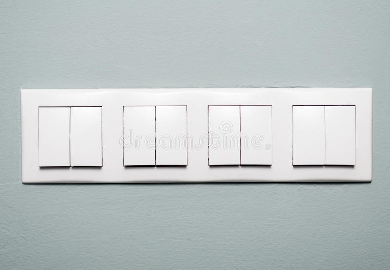 Close-up Of Multiple Light Switches On Blue Background Stock Photo ...