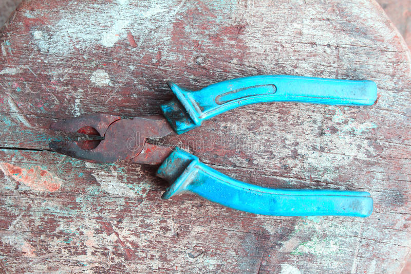 Close up of a multitool pliers on wooden royalty free stock photography