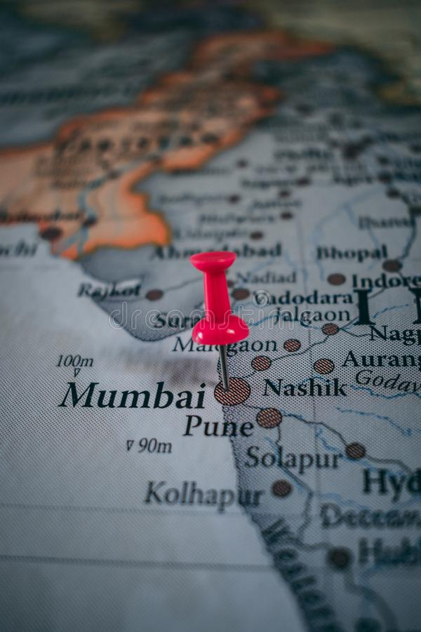 Close up of Mumbai pin pointed on the world map with a pink pushpin royalty free stock photography
