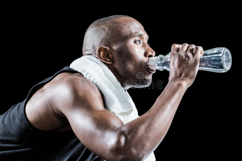Close-up of muscular man drinking water royalty free stock images