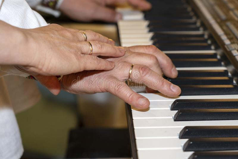 Close up of musician hands classic piano playing. Musician hands. Scene of pianist hands. Male musician playing midi keyboard stock image