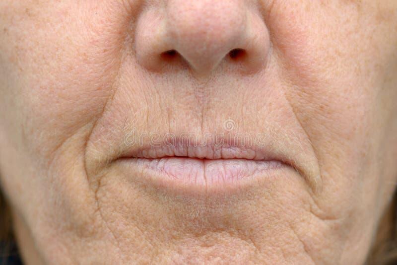 Close up na boca de uma mulher fotos de stock royalty free