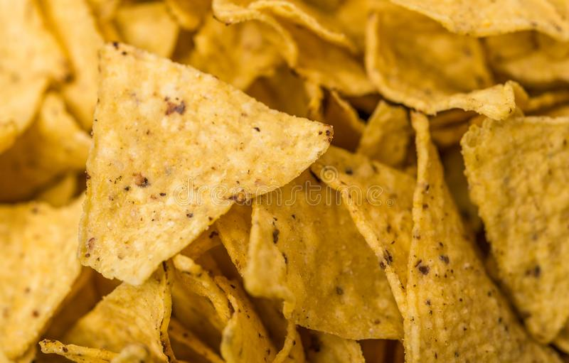 Close up of nachos chips, Mexican cuisine staple, at a street food market. royalty free stock images