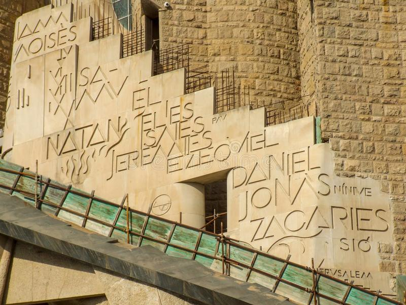 Close-up on names of biblical prophets names inscribed on front of the of Sagrada Familia Basilica in Barcelona. stock image