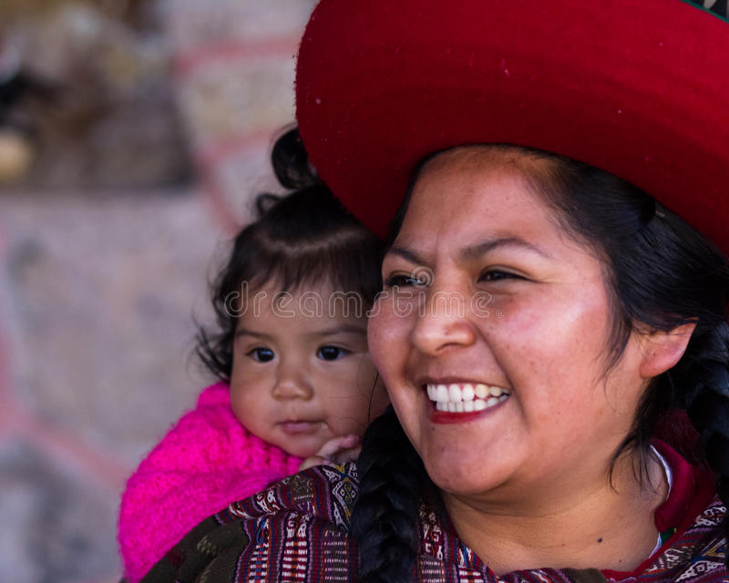 Close up of a Native Peruvian mother and her baby girl stock image
