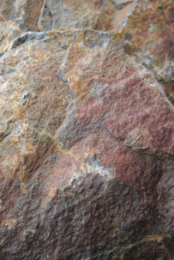 Close-up natural rock texture, ocher-red tones. Auvergne, Puy-de-Dome royalty free stock photos