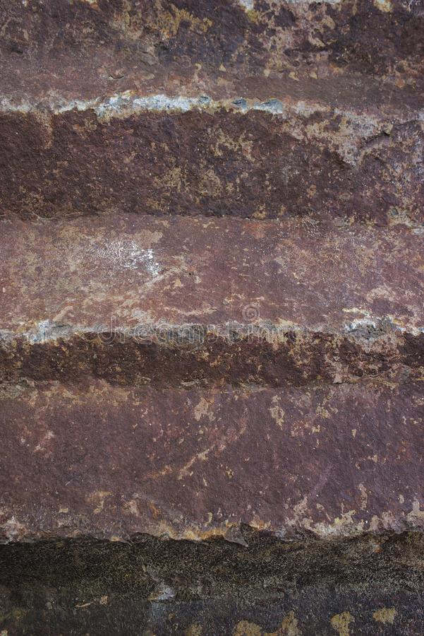 Close-up natural rock texture, ocher-red tones. Auvergne, Puy-de-Dome royalty free stock photo