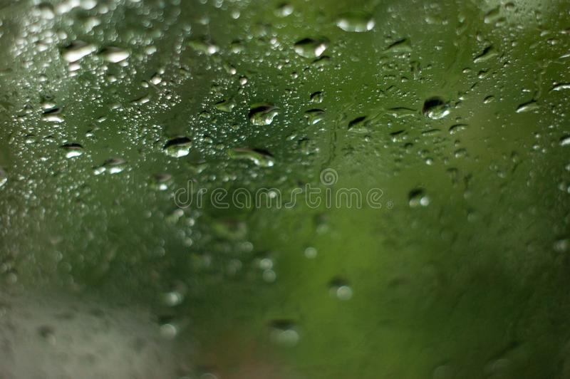Close up of natural water drops on glass texture. stock image