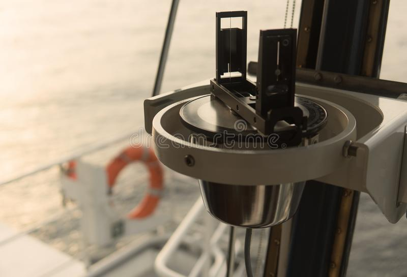 Close up of nautical marine magnetic compass on yacht or boat stock photography