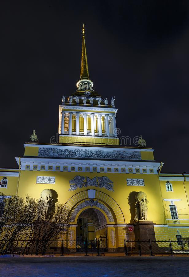 Close up neoclassical Admiralty Building, Saint Petersburg, Russia. Golden spire and main entrance of illuminated neoclassical Admiralty Building over night stock images