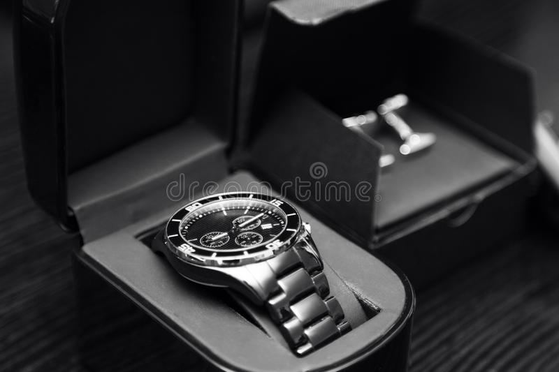 New elegant stainless steel silver men`s classic watches and cufflinks royalty free stock photos