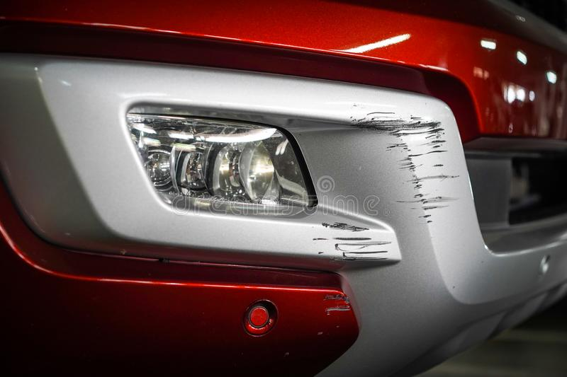 Close up New Scratch damage on the front of New red car royalty free stock photography