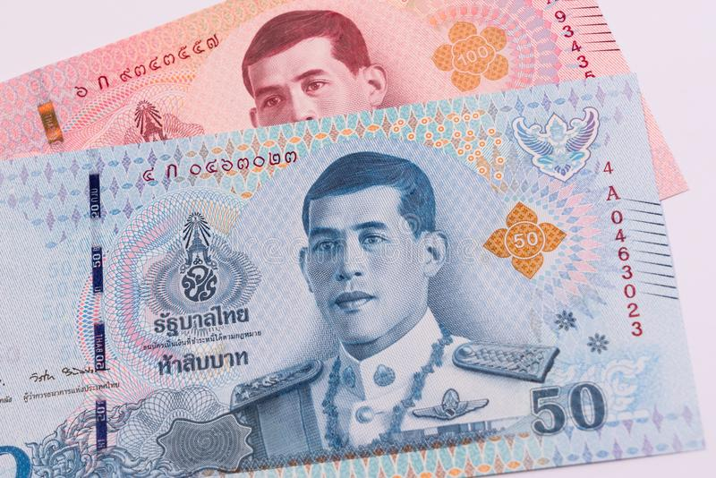 Close up of new 50 and 100 Thai baht banknote. stock photos