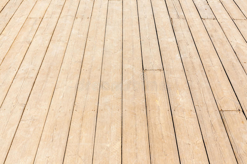 Close up new wood texture of floor with natural pattern. New wooden floor, close up rough wood texture of floor with natural pattern royalty free stock image