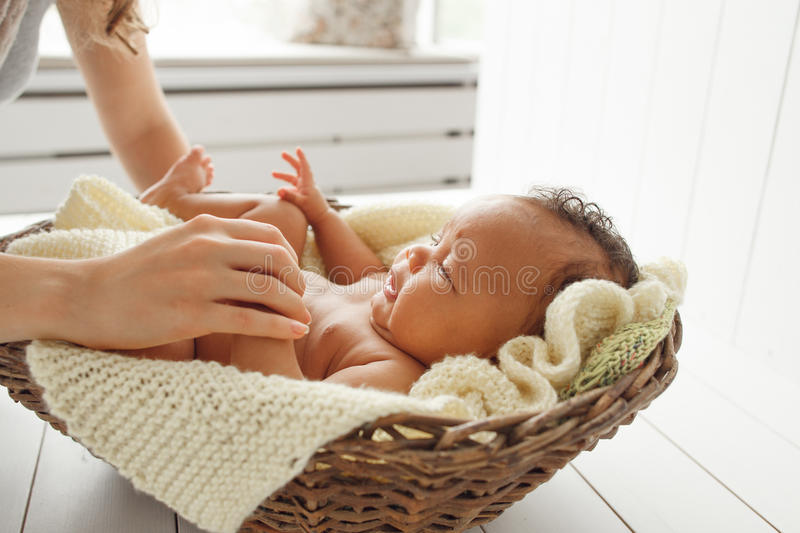 Close-up of newborn child playing with mother royalty free stock images