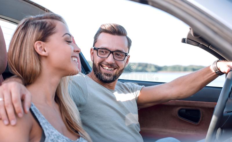 Close up.newlyweds traveling in a convertible car stock images