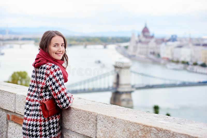 Close-up female looking back at camera against view Hungarian Parliament royalty free stock photo