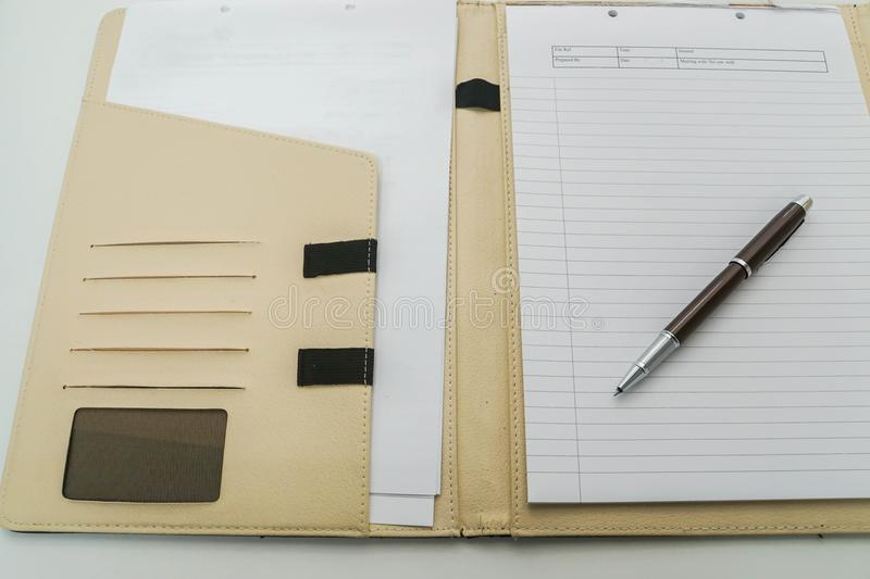 Close up notebook with pen in leather case on office desk for meeting stock photos