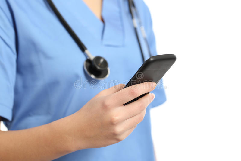 Close up of a nurse hand using a smart phone stock image