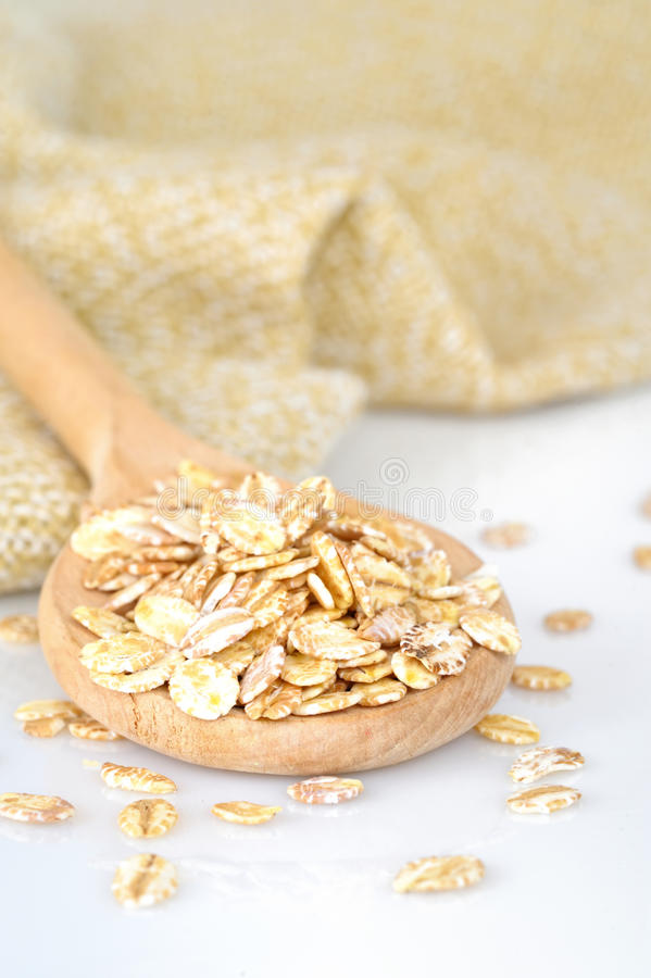 Download Close Up Of Oat Flakes In Wooden Spoon Royalty Free Stock Images - Image: 23871519