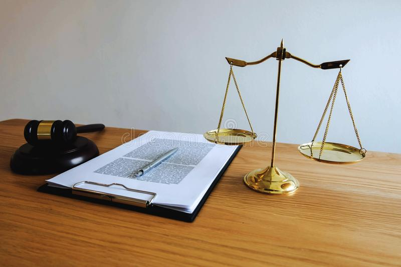 Close up object law concept. Judge gavel with justice lawyers a. Nd documents working on table royalty free stock image