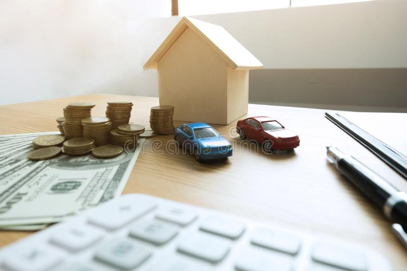 Close up object Money exchange with real estate. Contract on trading a car and house concept. stock photography