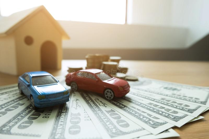 Close up object Money exchange with real estate. Contract on trading a car and house concept. royalty free stock photo