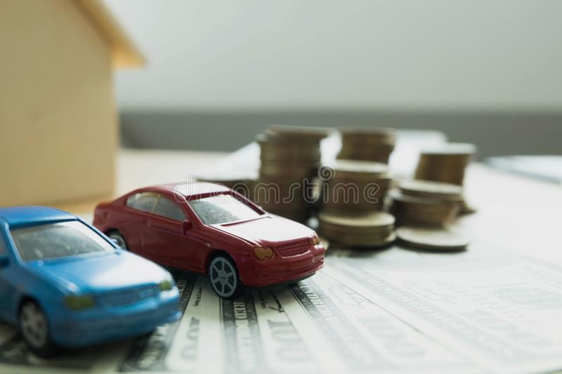 Close up object Money exchange with real estate. Contract on trading a car and house concept.  royalty free stock photography
