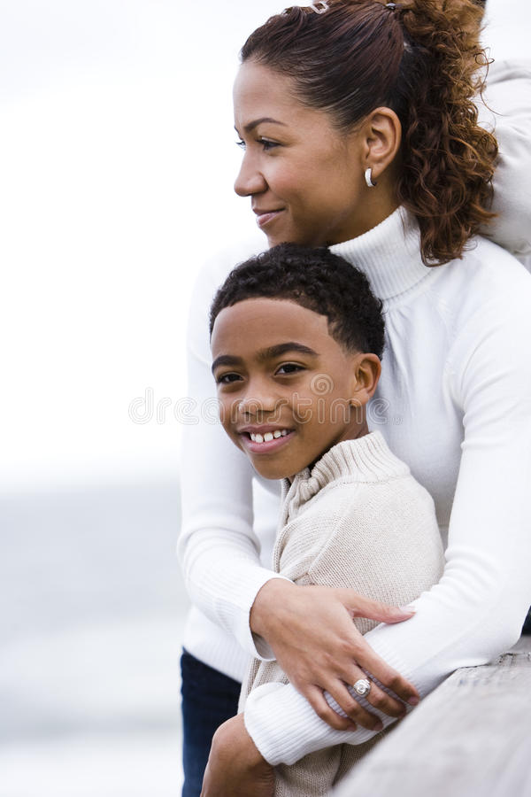 Free Close-up Of African-American Mother Embracing Son Stock Image - 12825351