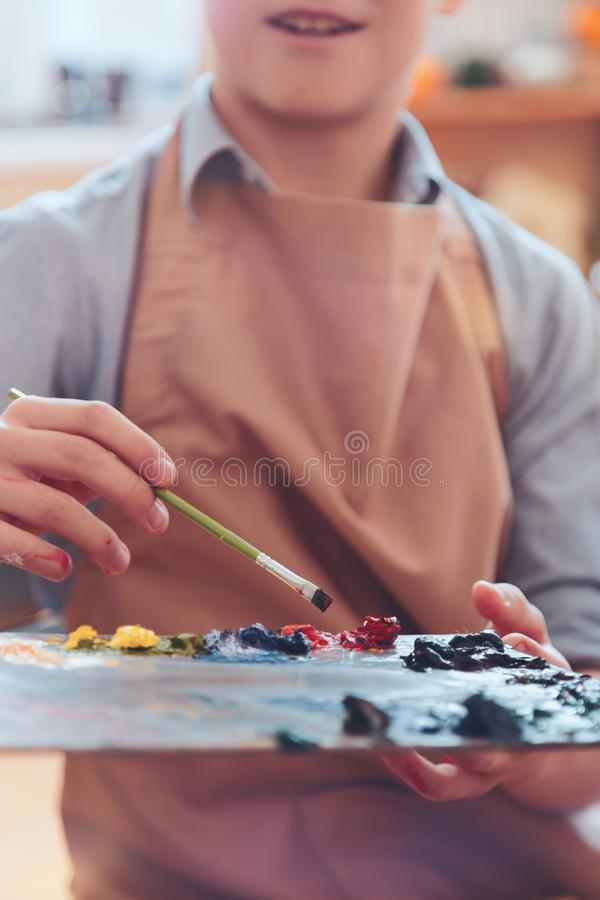 Free Close Up Of Boy Holding Palette With Multi Colored Paints Royalty Free Stock Images - 110291369