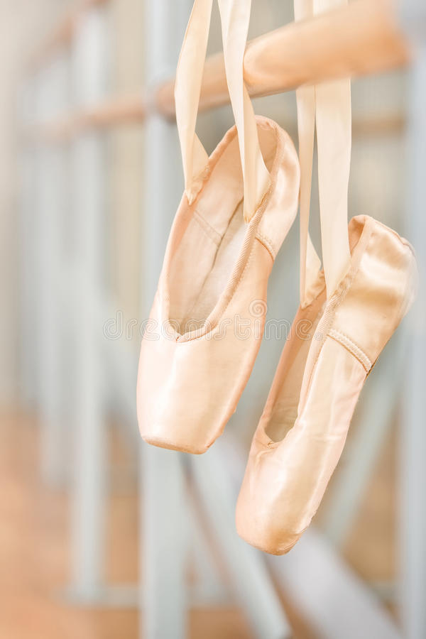 Free Close Up Of Pointes For Ballet Hanging On Barre Royalty Free Stock Image - 33919016