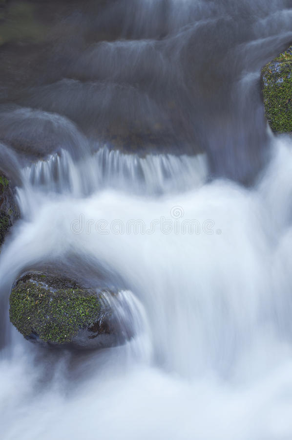 Free Close Up Of Rushing River Water Flowing Over Mossy Rocks Royalty Free Stock Images - 93362199