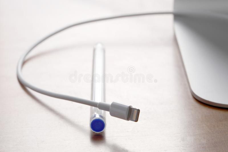 Close up on an office desk with wire and plug stock images