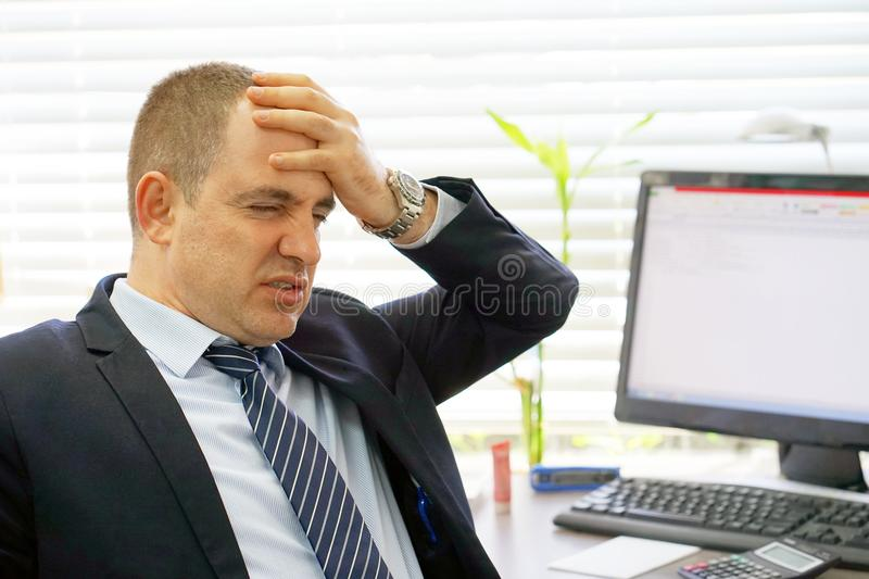 Composite image of businessman stressed out at work stock images