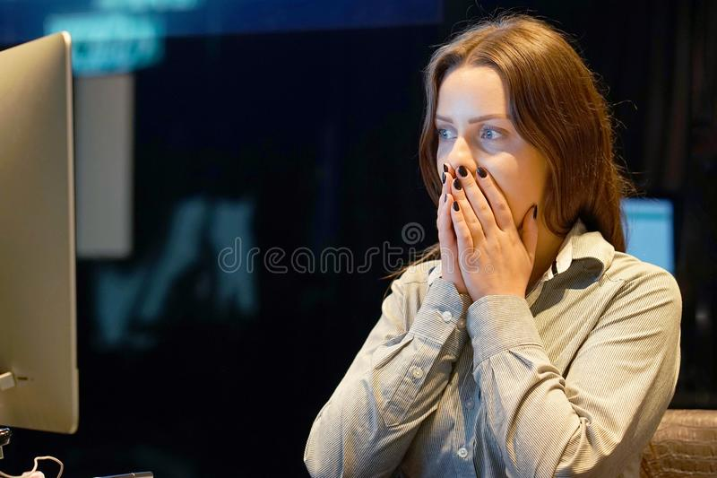 Woman in stress in front of computer royalty free stock photo