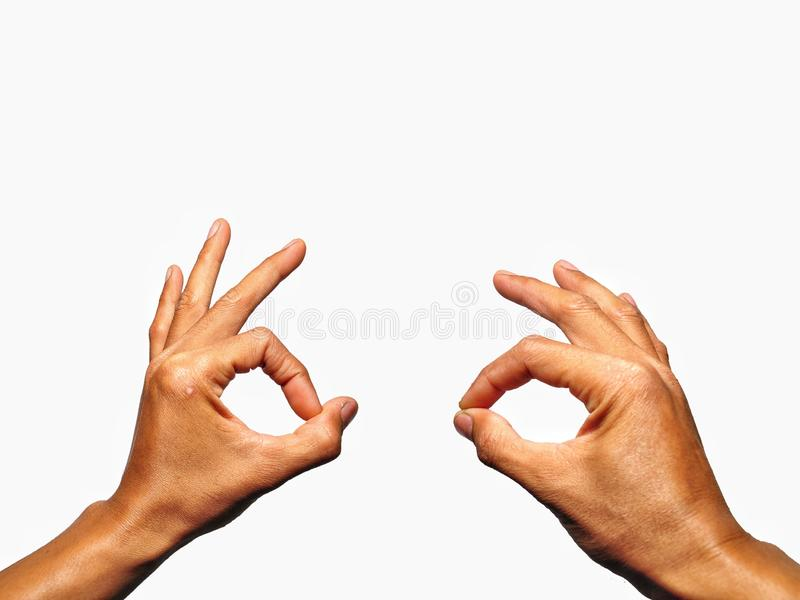 Close up OK hand gesture isolated on white backdround. Body part royalty free stock photo